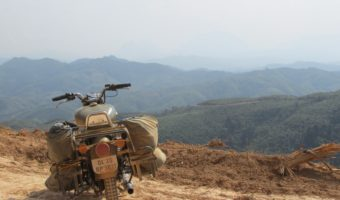 Riding along the rolling mountains of Laos